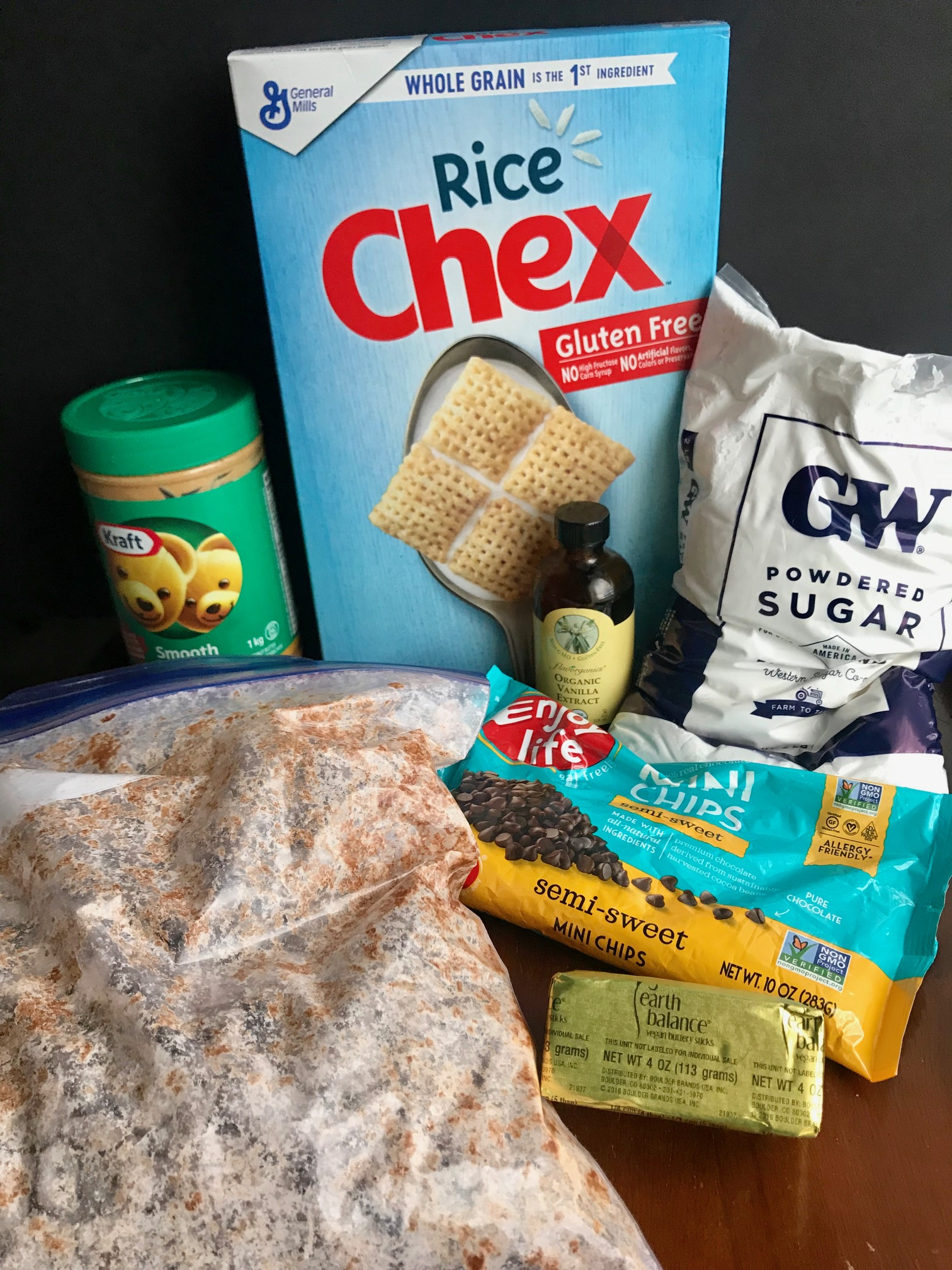The ingredients next to a bag of puppy chow.