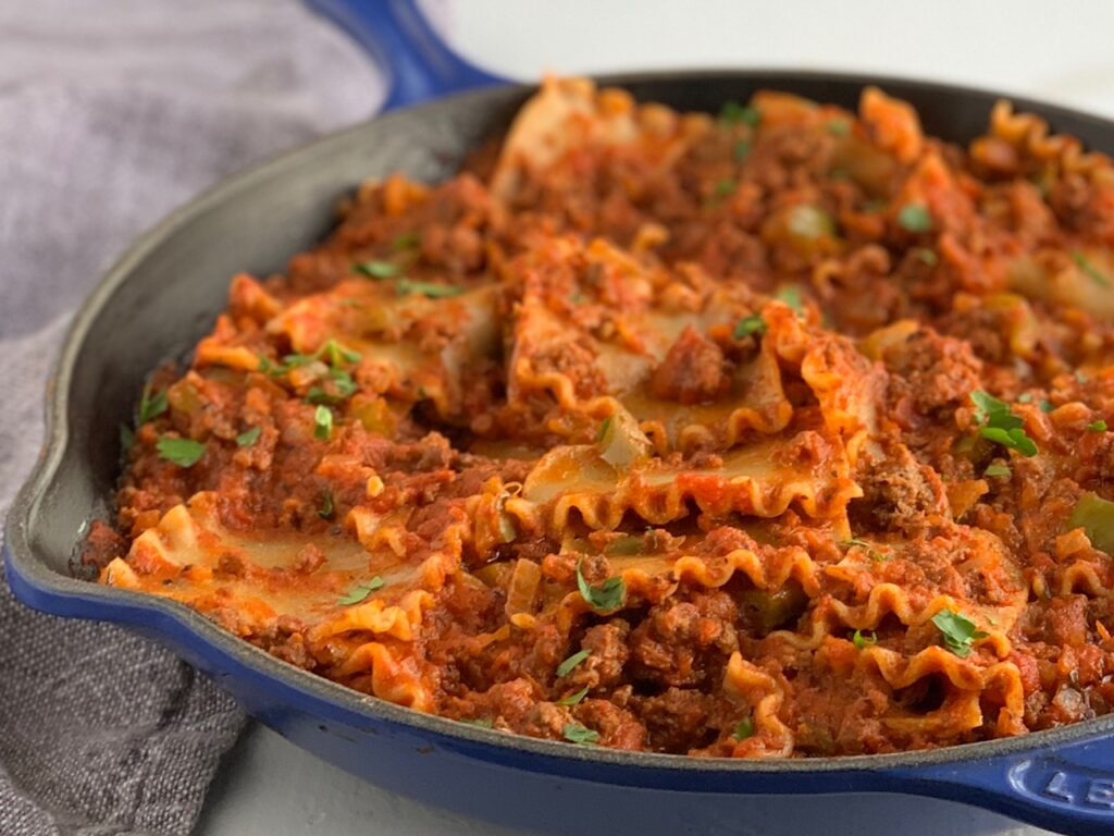 Lasagna noodles and pasta sauce in a large skillet