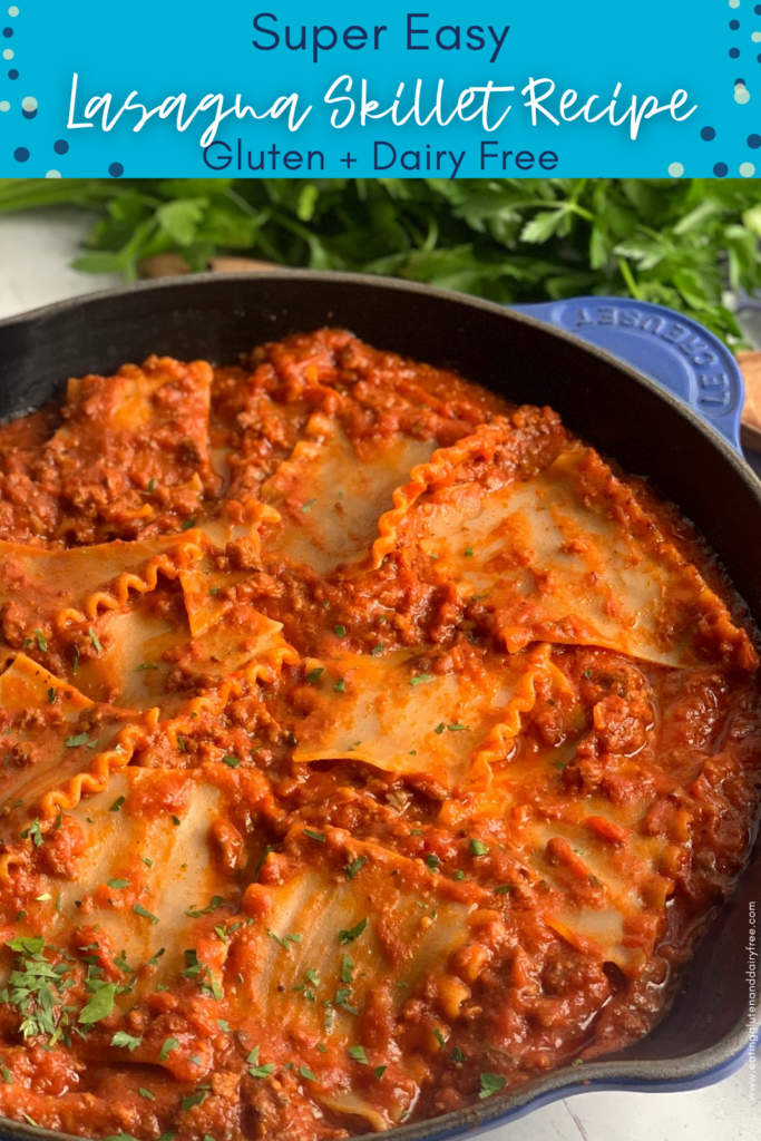 A skillet full of tender lasagna noodles broken up into smaller pieces with a hearty red meat sauce.