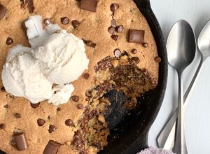 Ice cream melting on a giant cookie in a skillet