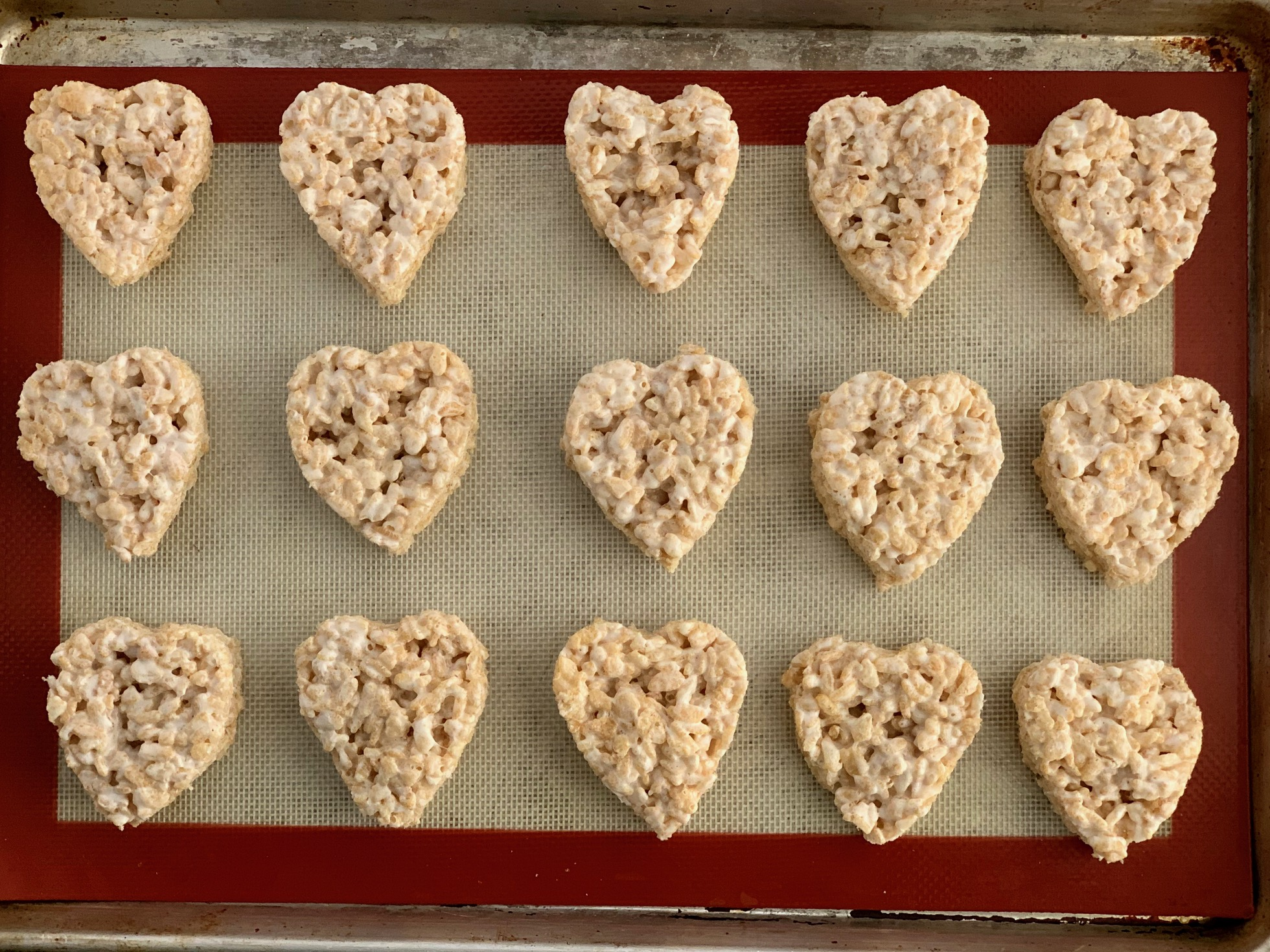 RIce Krispies cut out with a heart shaped cookie cutter.