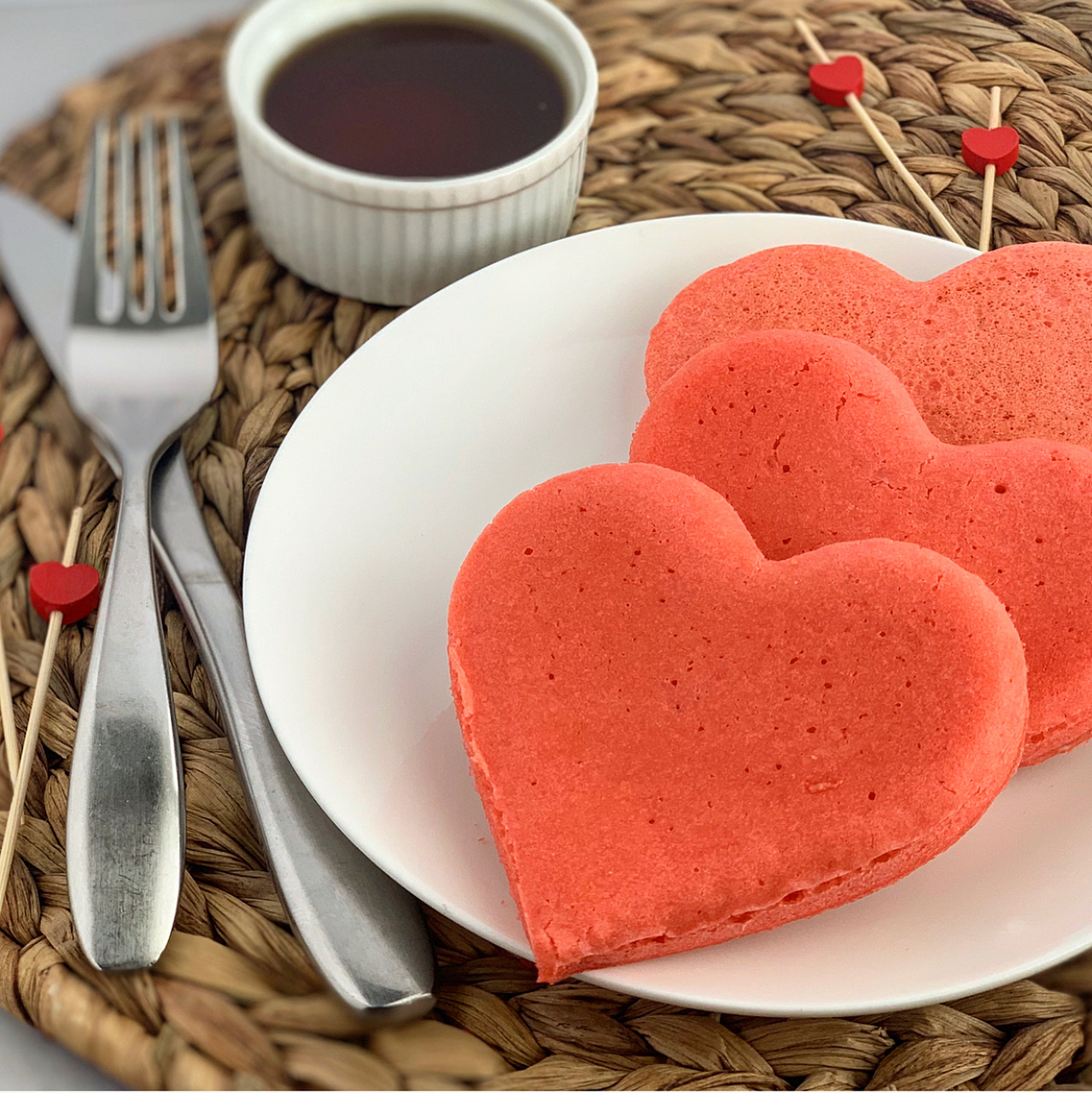 3 red pancakes in the shape of a heart