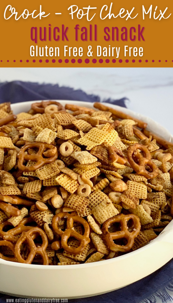 A yummy bowl of chex mix that has pretzels, chex cereal, peanuts, circle o's perfectly seasoned.