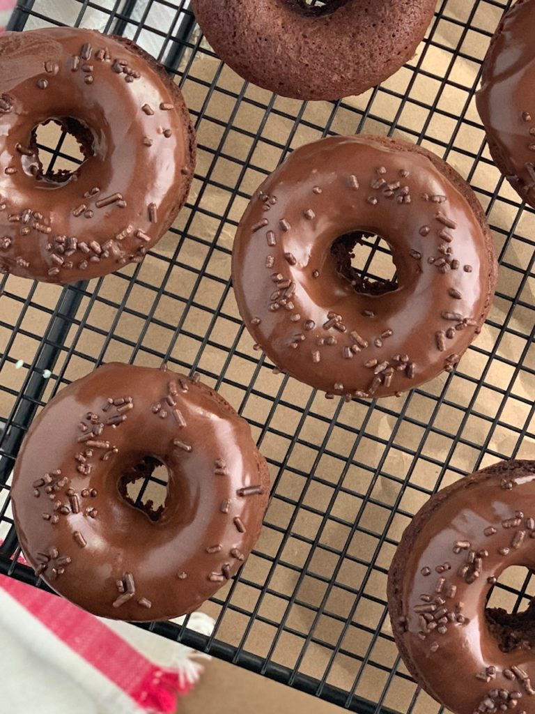chocolate donuts with chocolate sprinkles on top