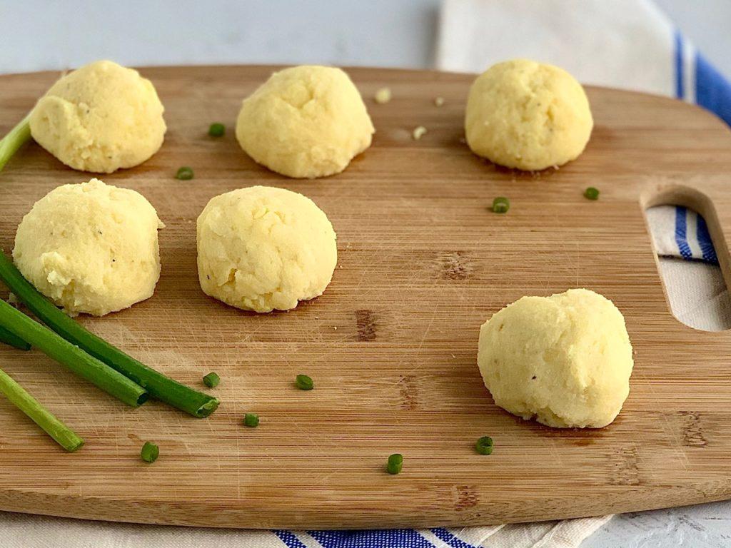 mashed potato balls ready to be fried