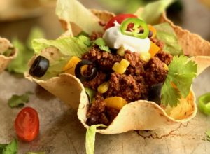 taco salad shells filled with taco meat and toppings