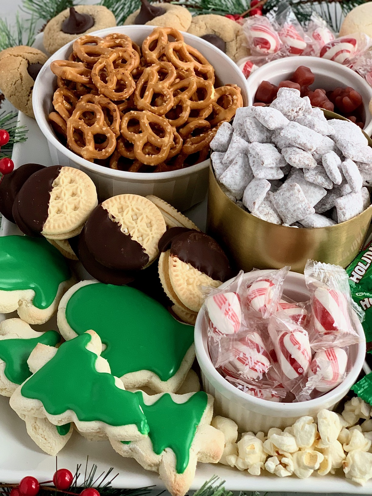 a close up of gluten and dairy free treats on a Christmas dessert board.