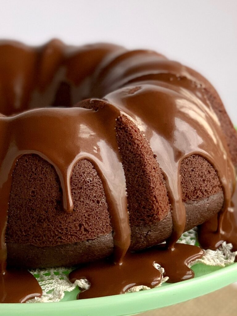 chocolate ganache drizzle on a chocolate fudge bundt cake