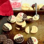 gluten and dairy free oreos dipped in dairy free white chocolate with sprinkles