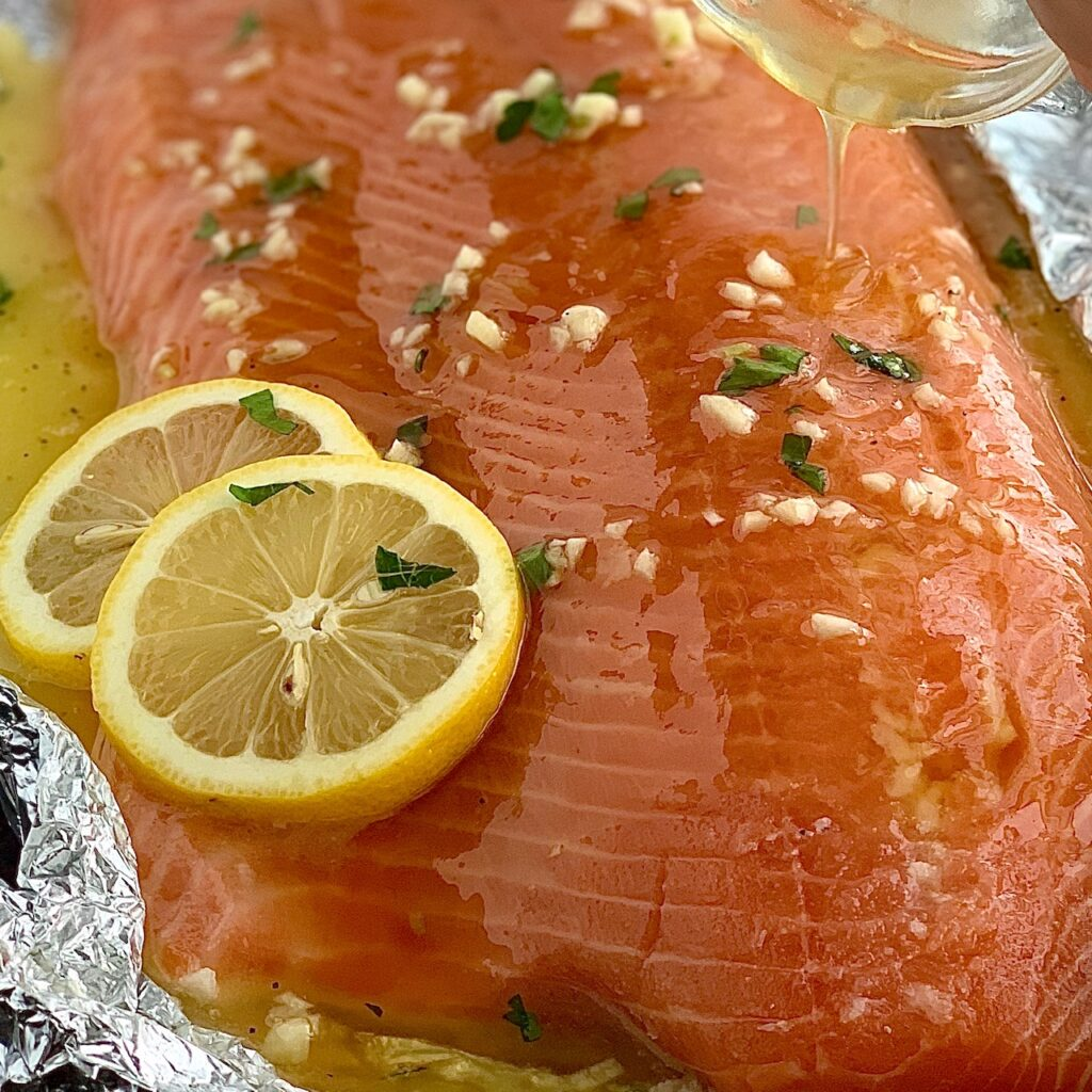 Salmon with glaze being drizzled on it