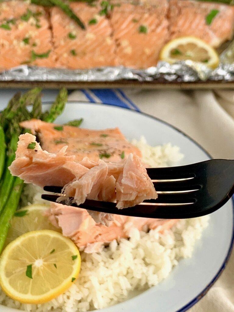 Flaky salmon on a fork