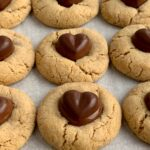 Heart Peanut Butter Blossom Cookies on a baking pan