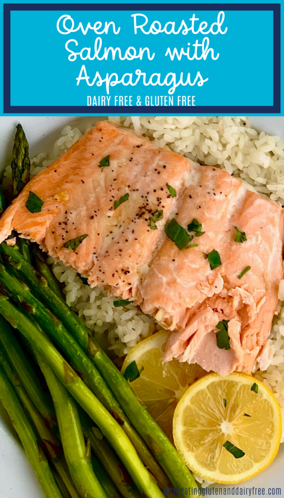 A plate full of oven roasted salmon, rice, and asparagus.