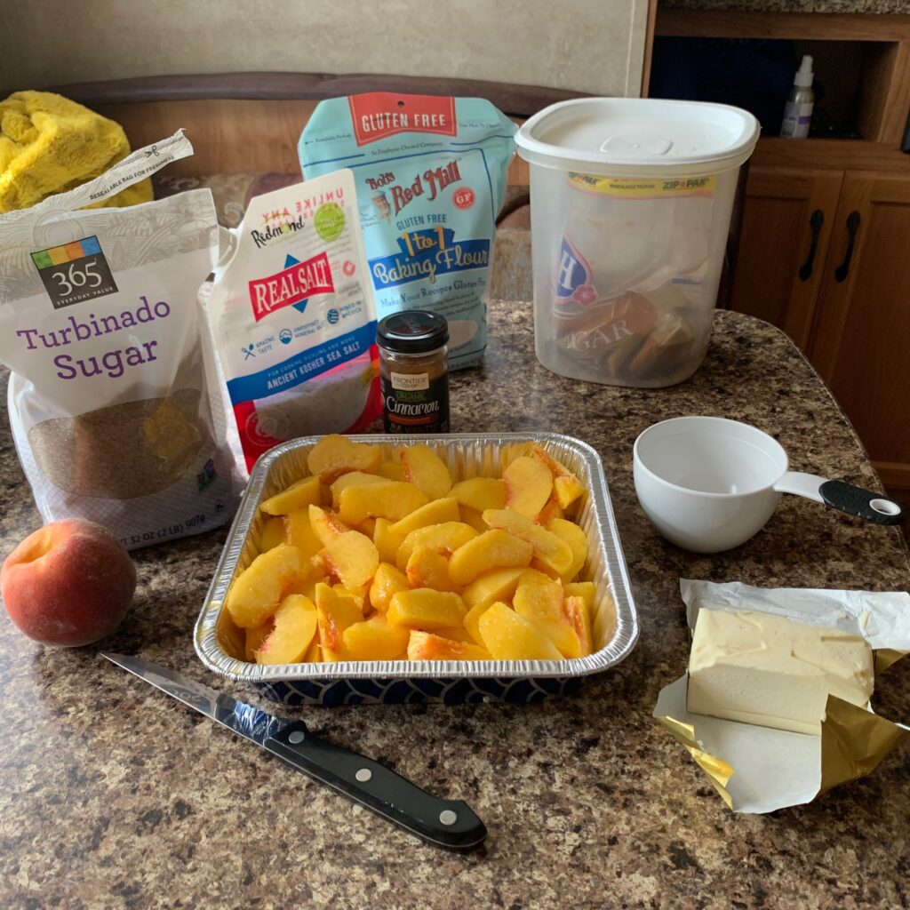 All of the ingredients for baking a fresh peach crisp