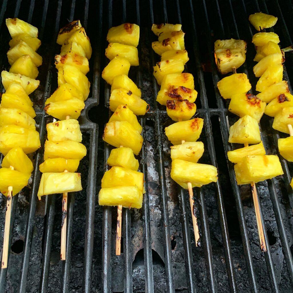 Pineapple on skewers grilling