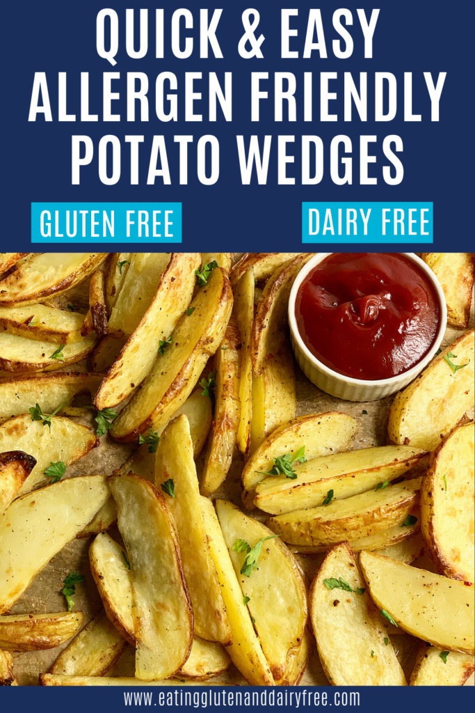 A baking sheet full of baked potato wedges garnished with dried parsley with a small container of ketchup.