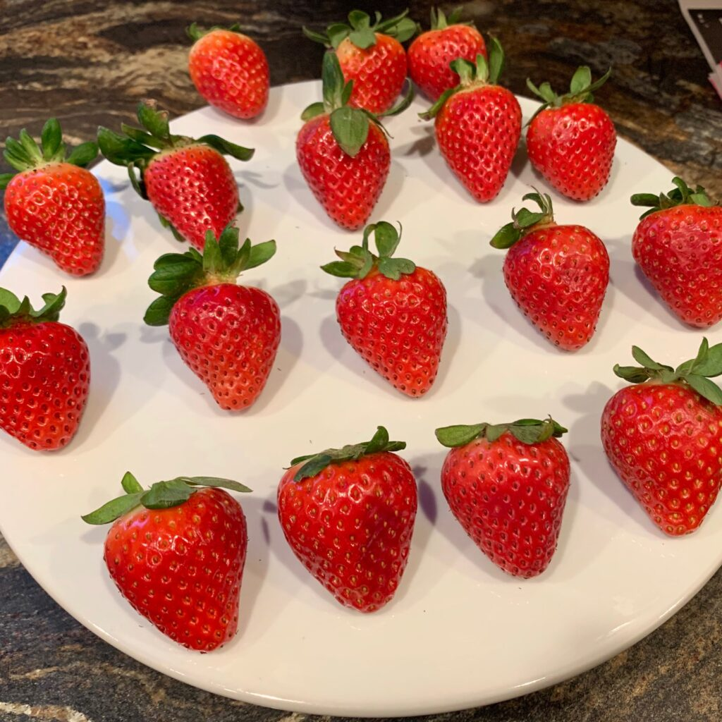 strawberries lined up on a platter