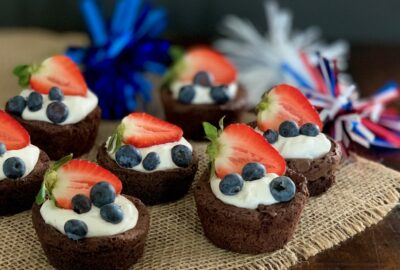 mini brownies with whipped topping and fruit