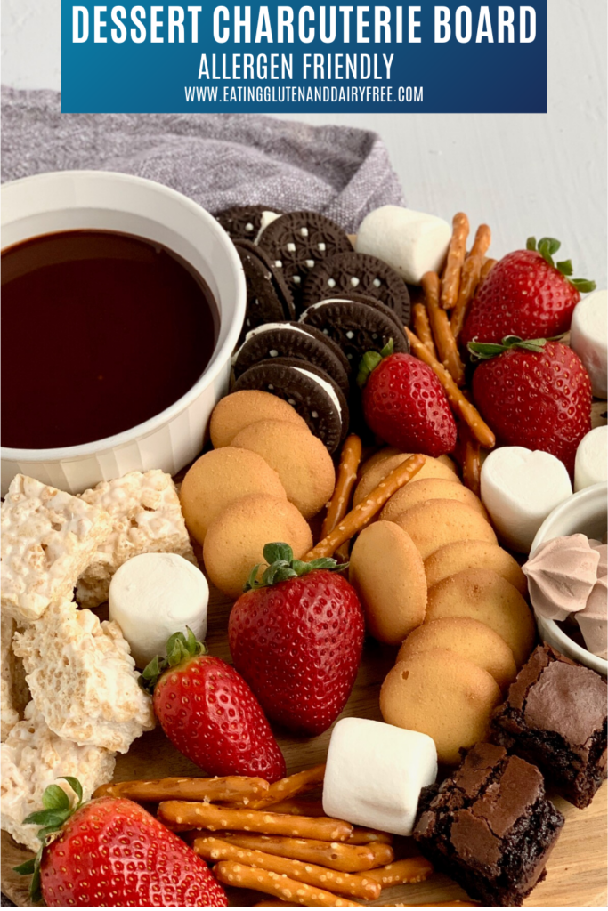 A variety of treats such as oreo cookies, strawberries, marshmallows, pretzel rods, marshmallow treats and ganache dipping sauce.