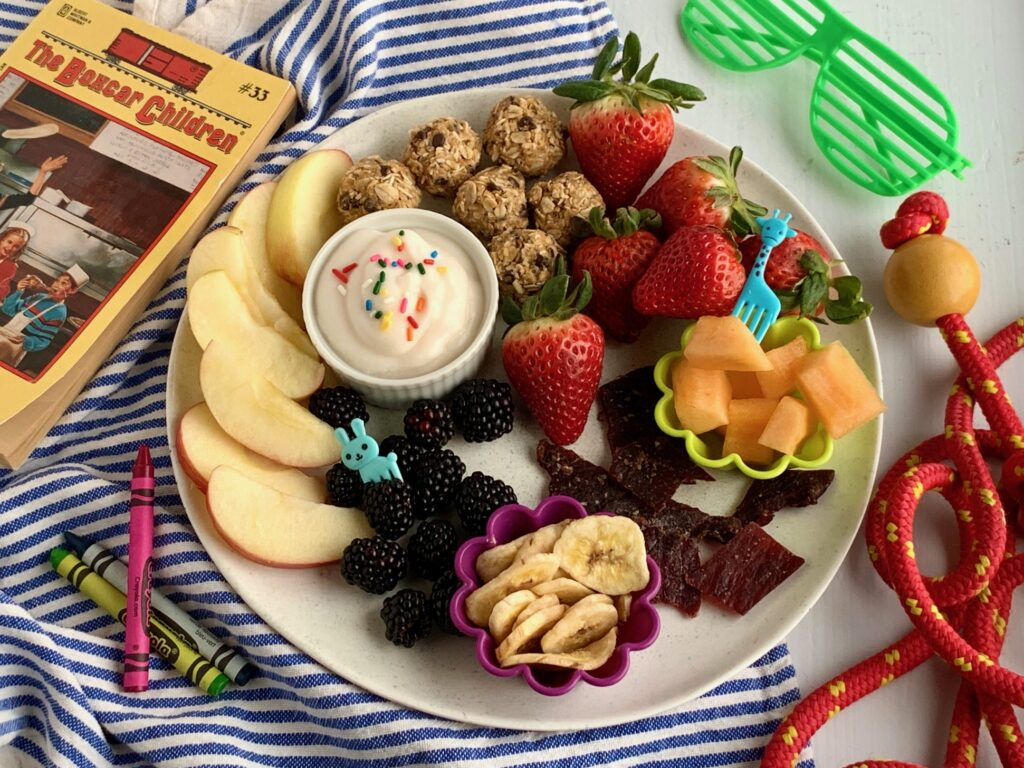 Several kid friendly snack ideas on a plate