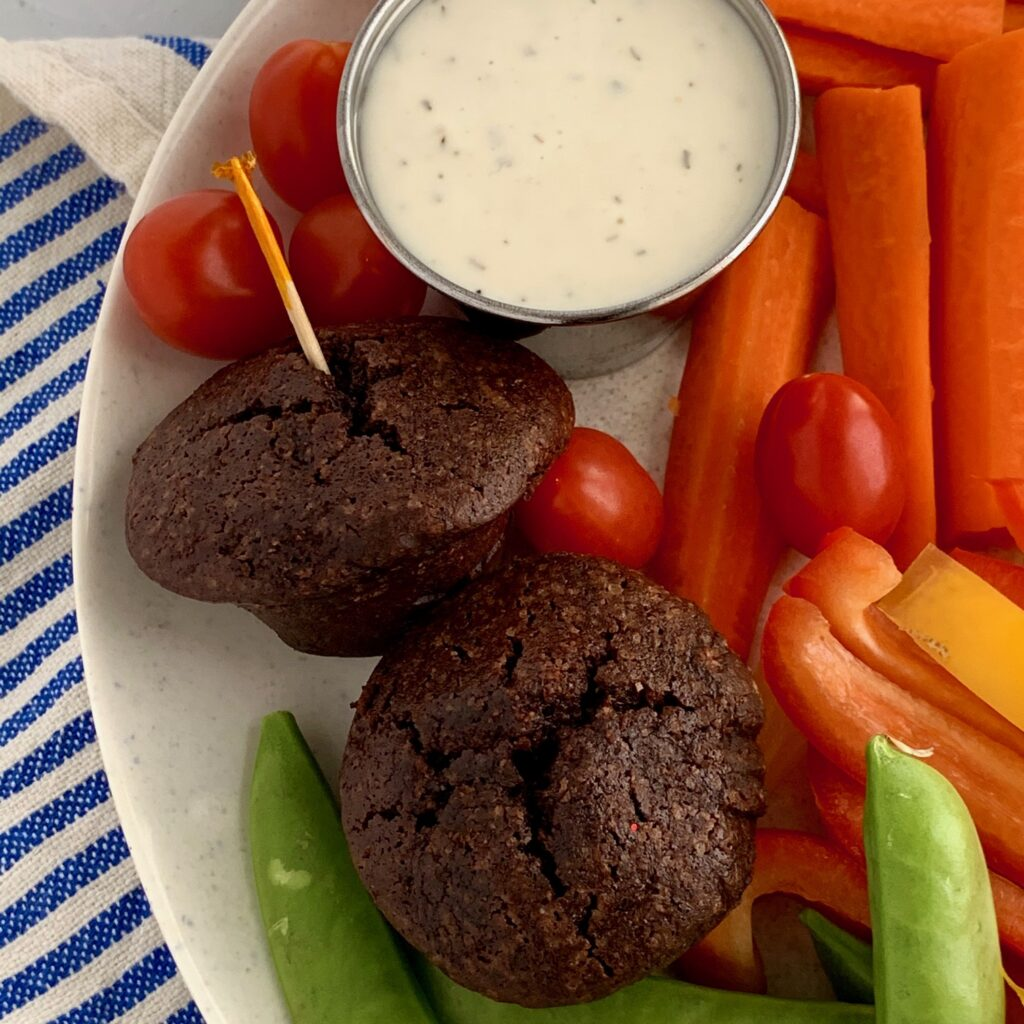 Several kid friendly snack ideas on a plate with Just Ranch dipping sauce