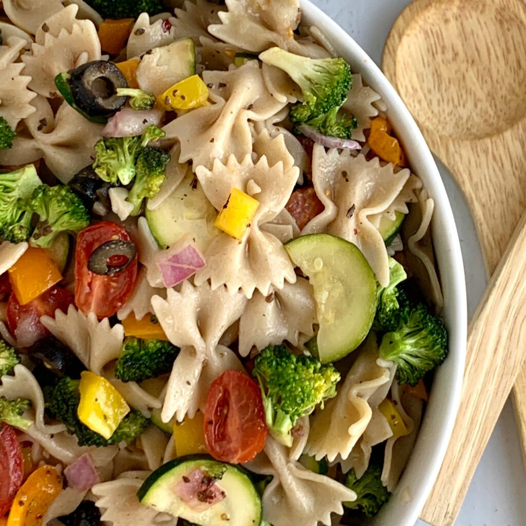 A close up of veggie pasta salad in a serving bowl.