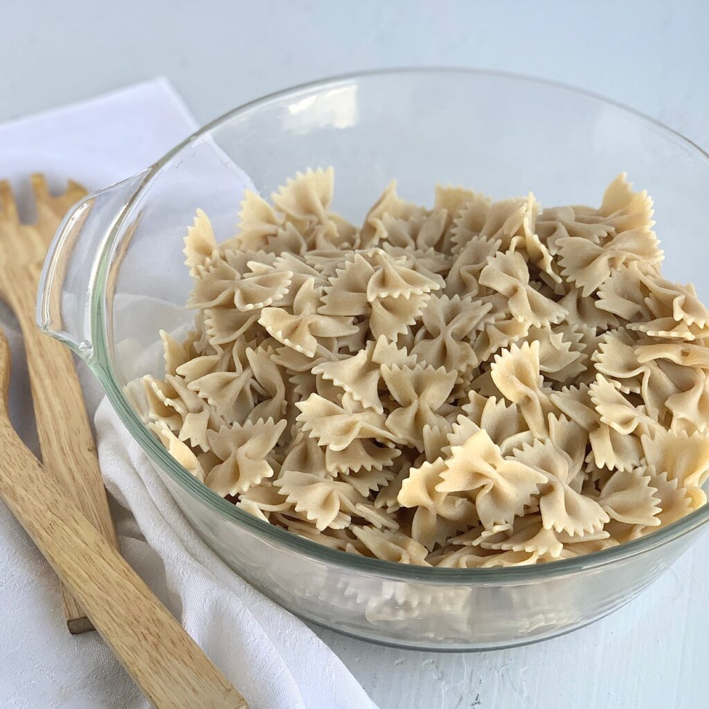 A large bowl of gluten free bow tie pasta.