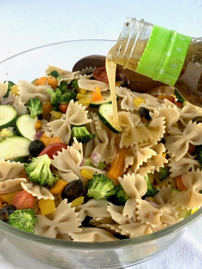A serving bowl filled with delicious veggie pasta salad.