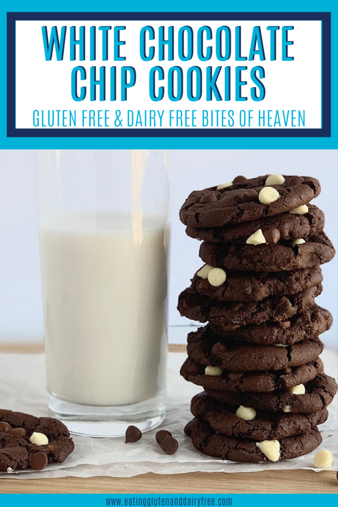 A stack of white chocolate chip cookies next to a glass of almond milk.