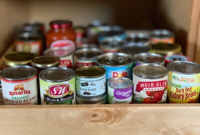 A pantry full of canned goods.
