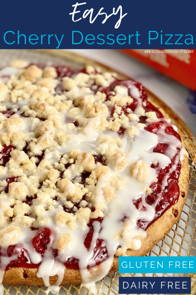 A pizza crust with cherry pie sauce on it with a crumble topping and grizzle.