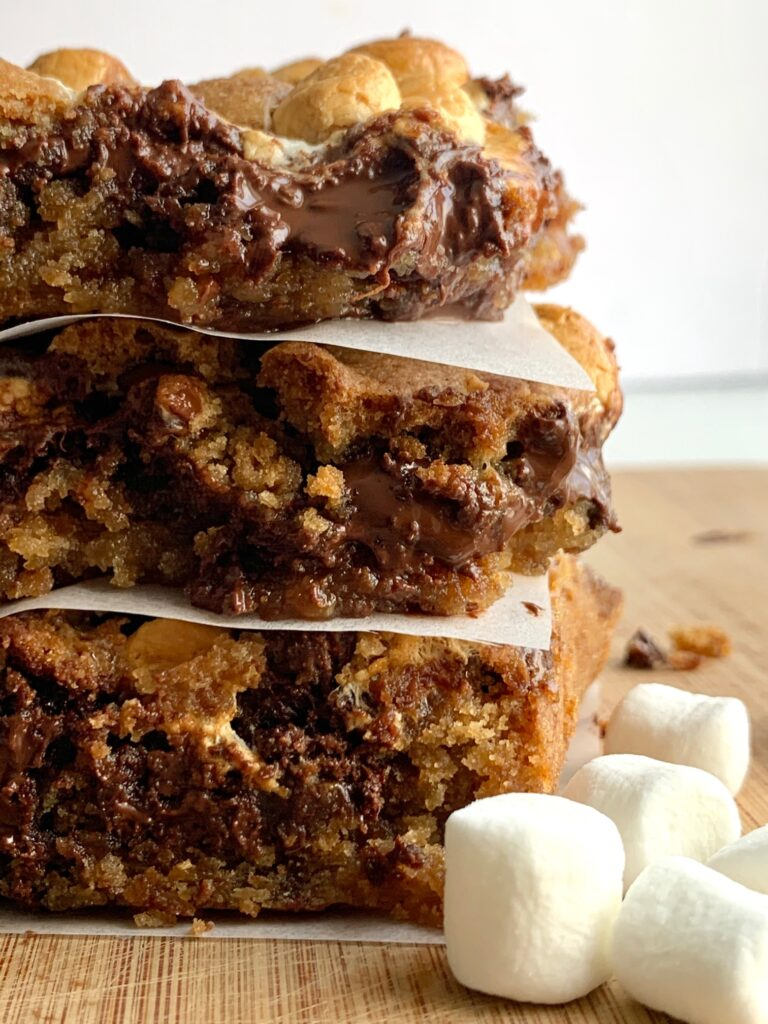 3 stacked s'more cookie bars with melted chocolate