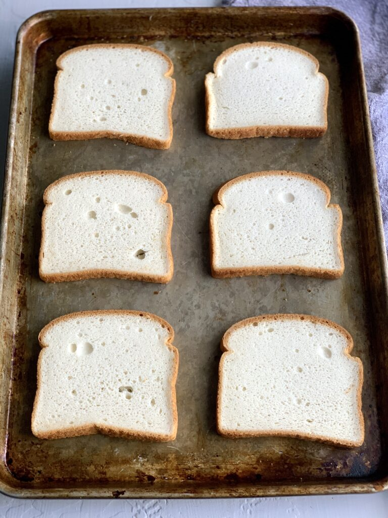 A baking sheet with 6 slices of bread on it