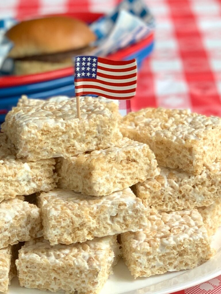 rice krispie squares cut and on a platter with 4th of July decorations