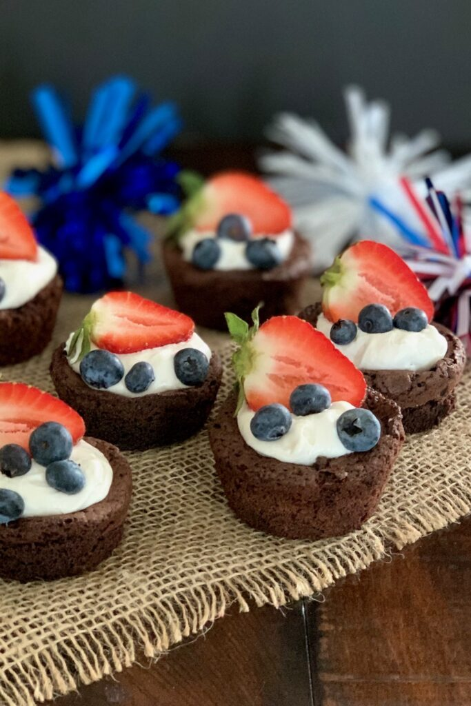 Brownie bites with cocowhip, blueberries, strawberries and 4th of July decorations