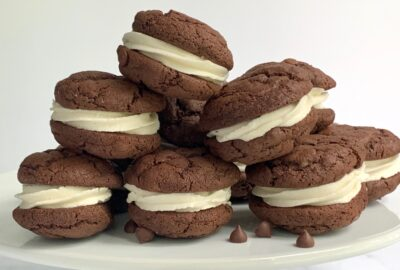 A plate of brownie cookie sandwiches