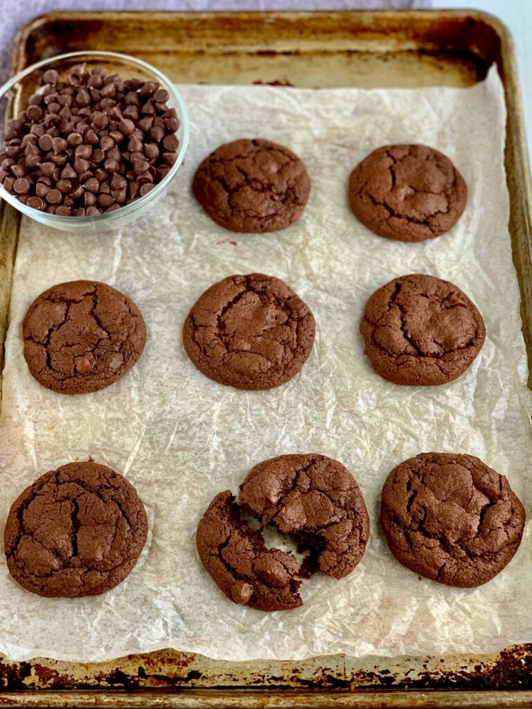 Fudgy brownie cookies on a baking sheet.
