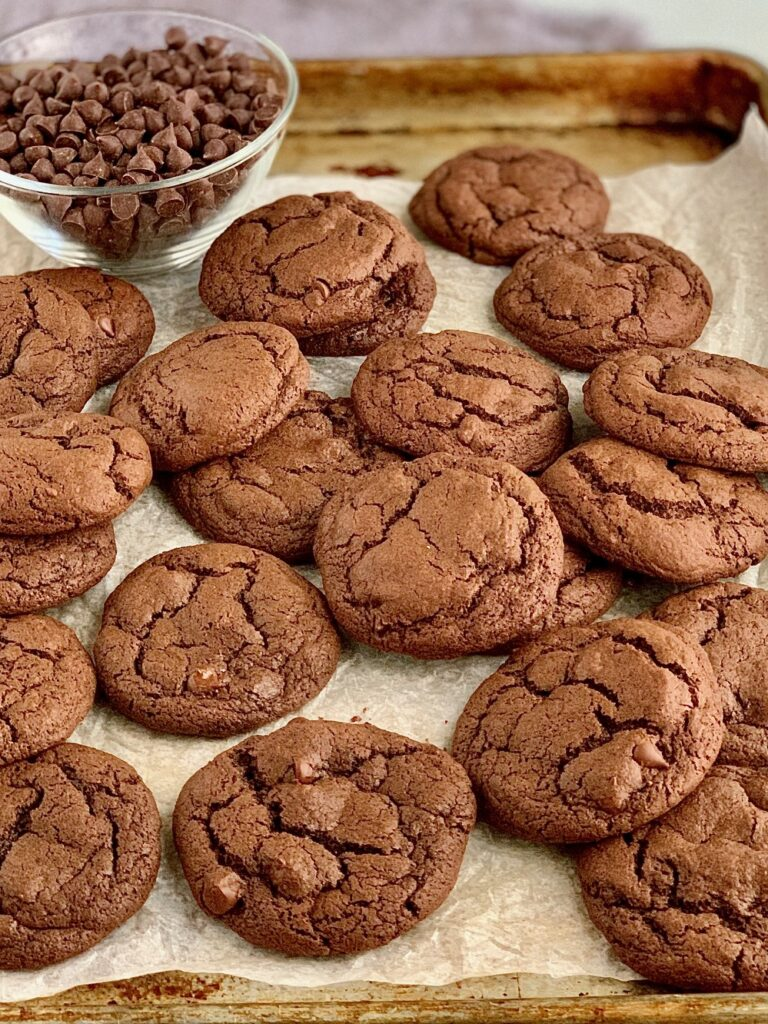 A pile of Fudgy brownie cookies on a cookie sheet.
