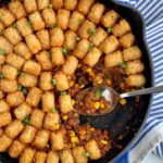 Ground beef, corn, black beans, with a mixtures of sauces and spices topped with tater tots.,