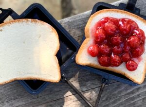 A slice of bread with cherry pie filling