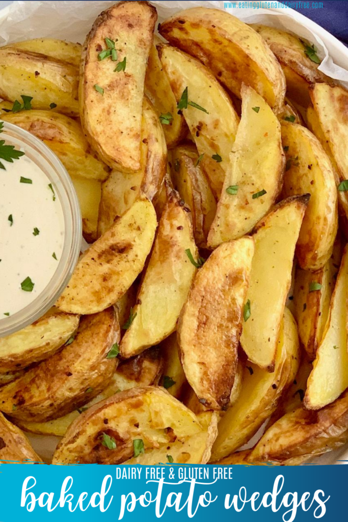 Crispy baked potato wedges on a plate with dip.
