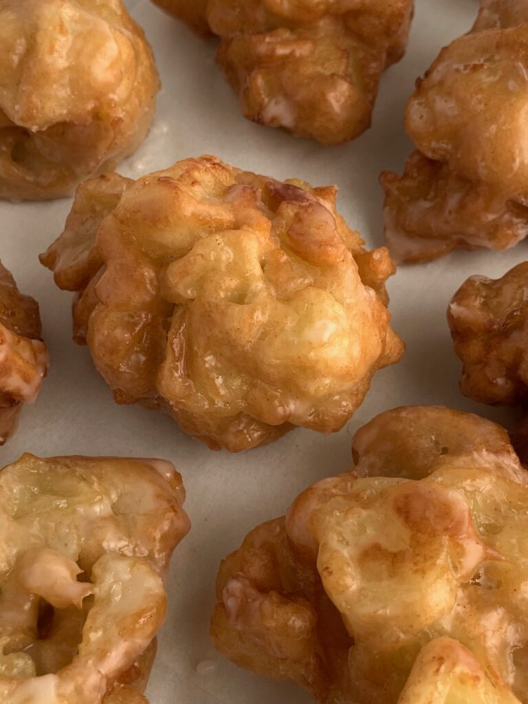 fresh fried apple fritters with a delicious glaze on top