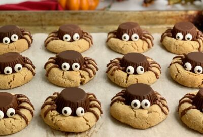 Peanut butter cookies with an upside down peanut butter cup, with edible eyes, and frosting for 4 legs on each side.