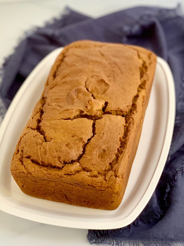 A loaf of pumpkin bread on a serving plate.