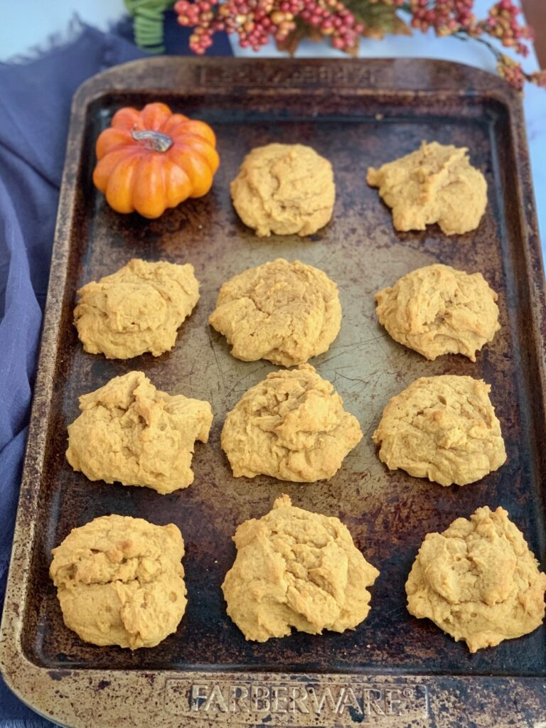 A sheet pan of pumpkin cookies before they're frosted.