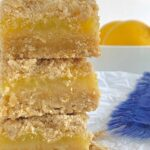 A stack of layered lemon streusel bars