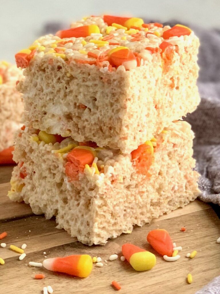 a stack of rice krispies with candy corns on top