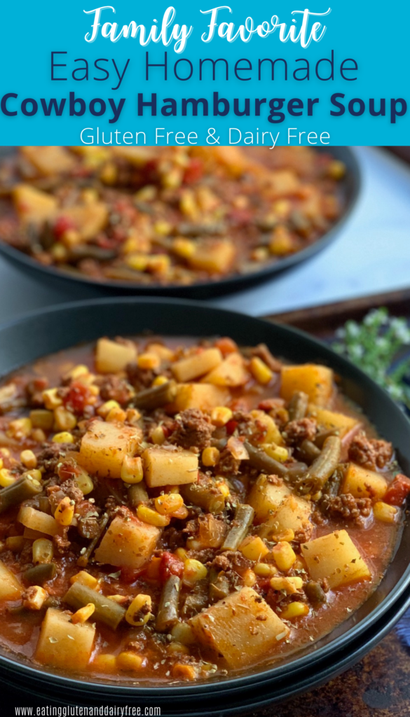 A large black bowl filled with tender potatoes, chunks of ground beef, corn, green beans, fire roasted tomato, broth, and a tomato juice combination.