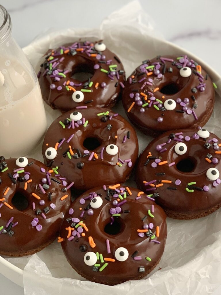 6 chocolate donuts with ganache icing and Halloween inspired sprinkles.
