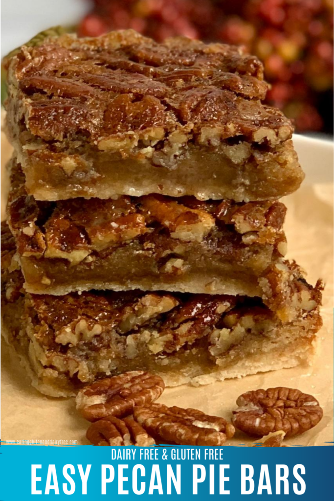 Layered pecan bars stacked on top of each other.